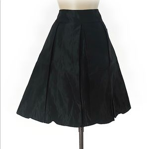 Knee length pleated black skirt